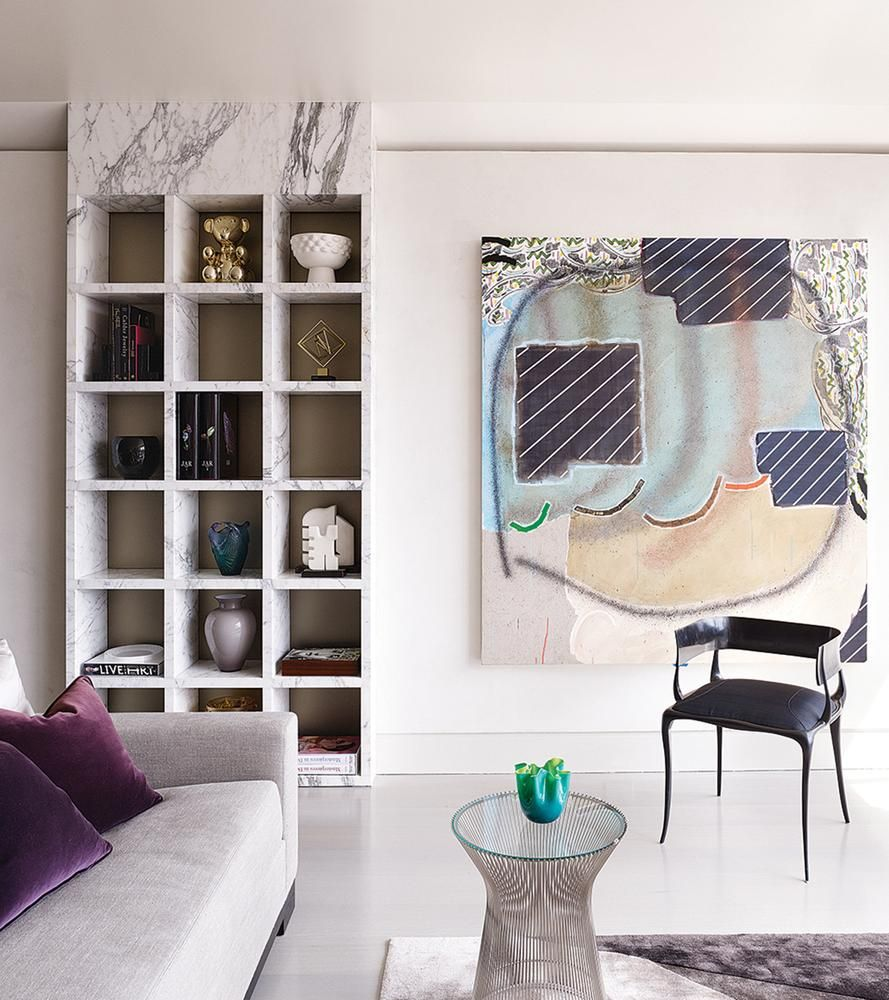 A Marble Bookshelf Custom Designed By Interior Architect Rafael De Cárdenas  Alongside A Painting By Allison Miller And A Paul Mathieu Armchair.