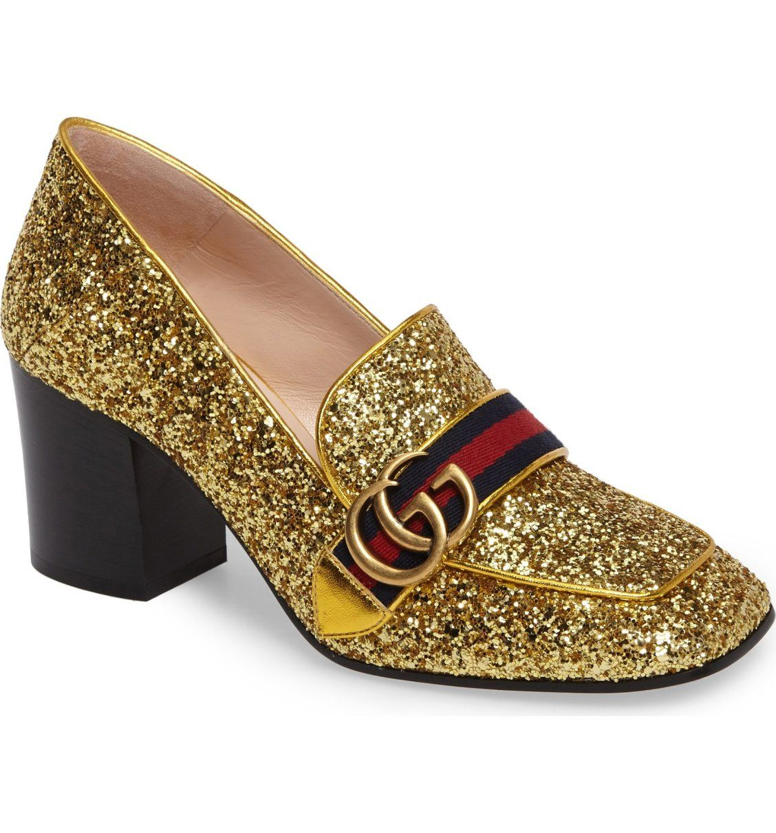 d5a13e19381 Gucci s trademark GG logo and grosgrain web bridge the vamp of a square-toe  loafer awash in sparkling metallic glitter.