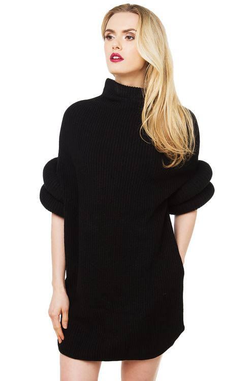 026bcffbc4 The Gracia Jetson Sweater Dress in black features a wide mock neck collar,  round donut-look sleeves, a curved hem, and side pocket detail.