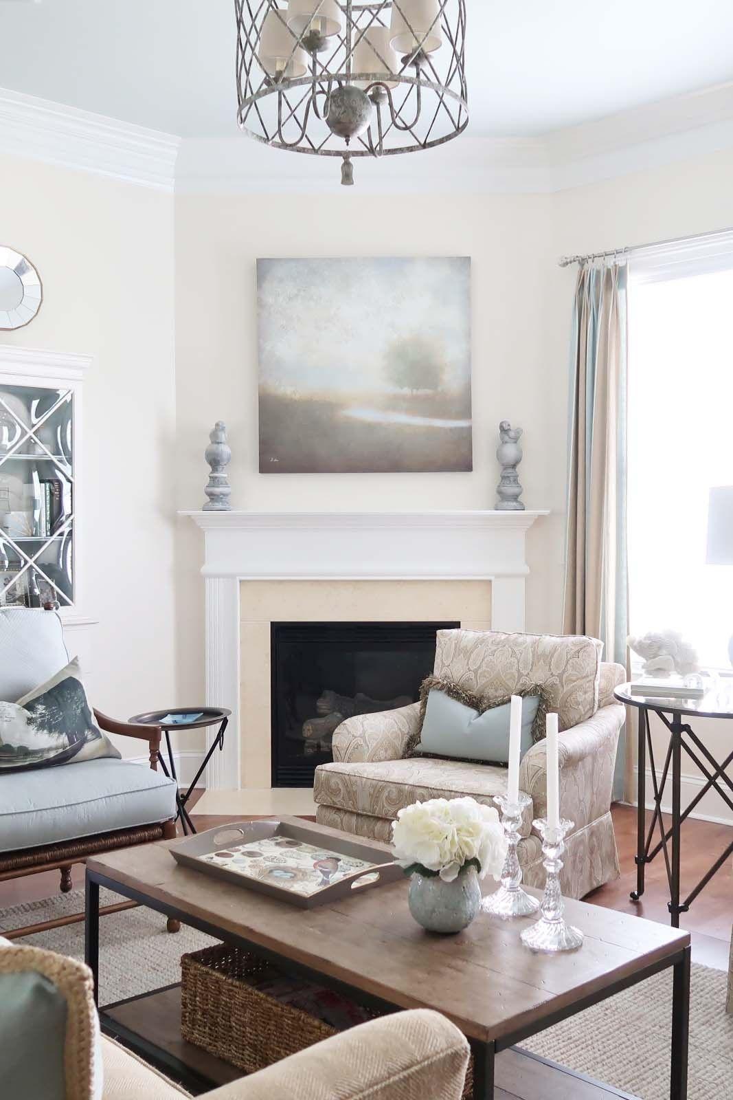 Family room light fixture hanging above coffee table coastal decor
