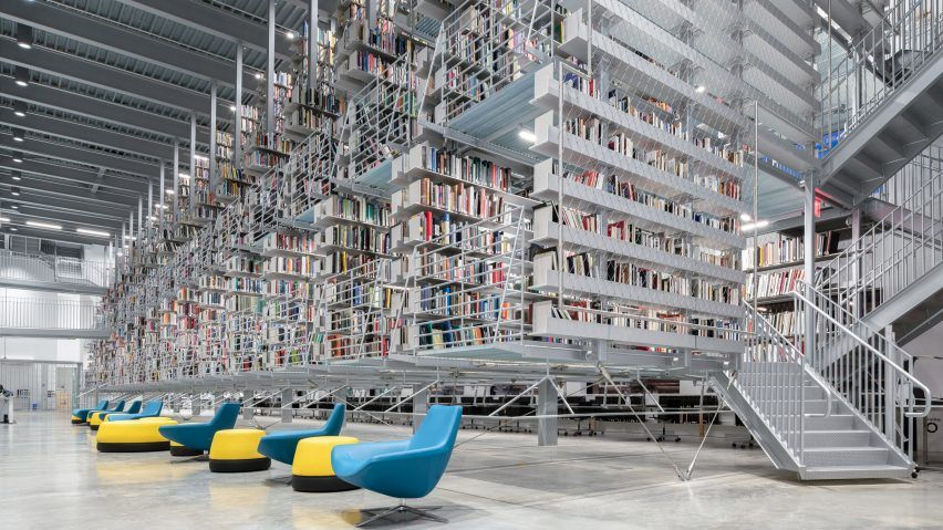 Architecture Firm Wolfgang Tschapeller Has Renovated A Library At Cornell University And Added Suspended Shelving Whi Cornell University Library City Library