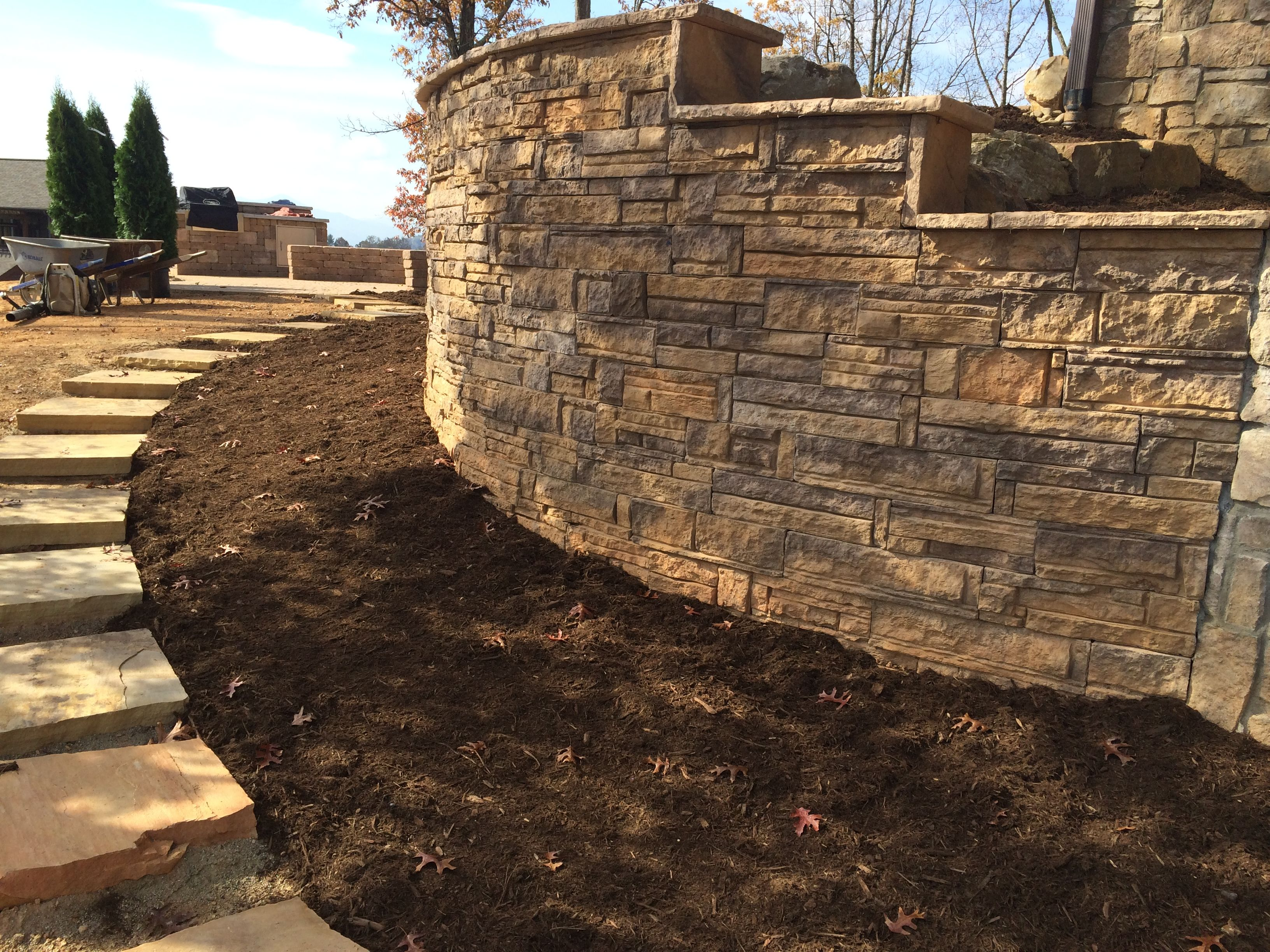 Retaining wall with Crab Orchard natural step rocks. By Carefree Landscapes.