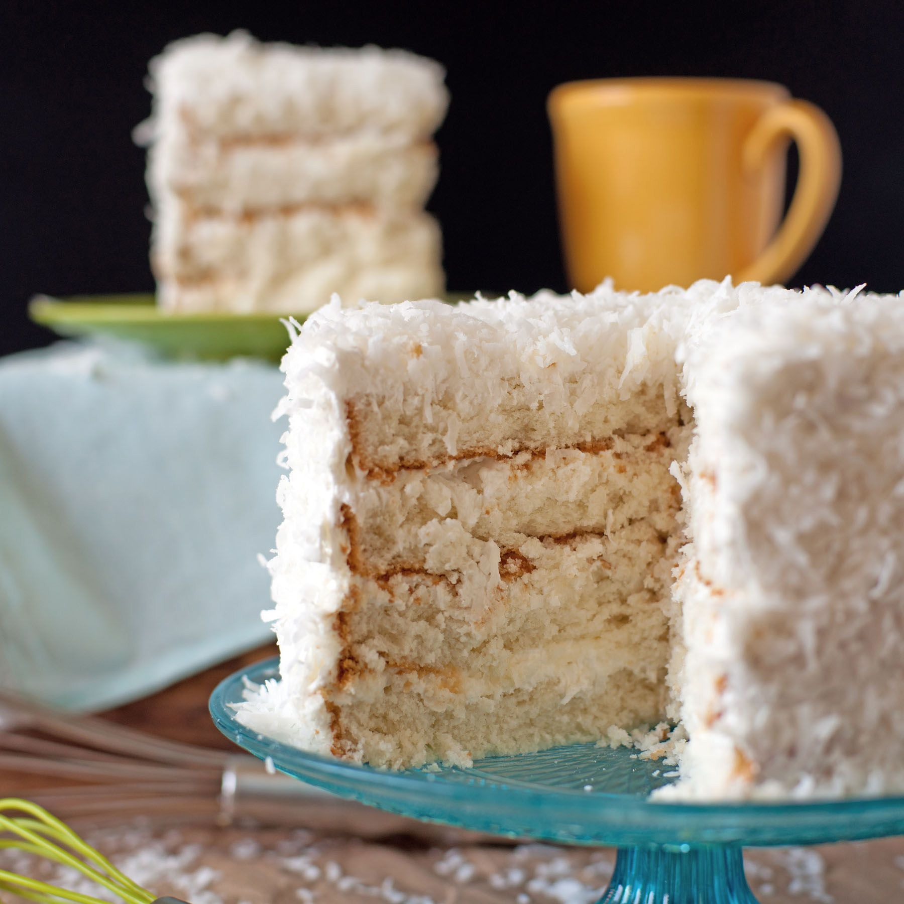 Coconut cake with sour cream whipped icing sour cream