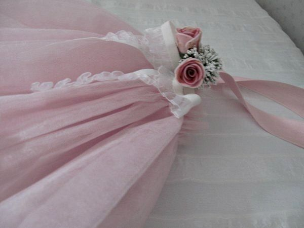 This tutu made from pink tulle,flowers,ribbon.You can use it on your baby's door or wall .Pink baby booties for 6-12 months.