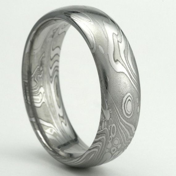 damascus stainless steel wedding band 7mm by mokumedamascusrings