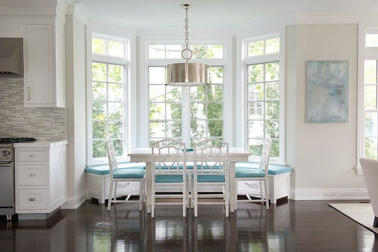 Stunning breakfast nook features Robert Abbey Porter Pendant over built-in  banquette which doubles as window seat accented with turquoise cushions  paired ...