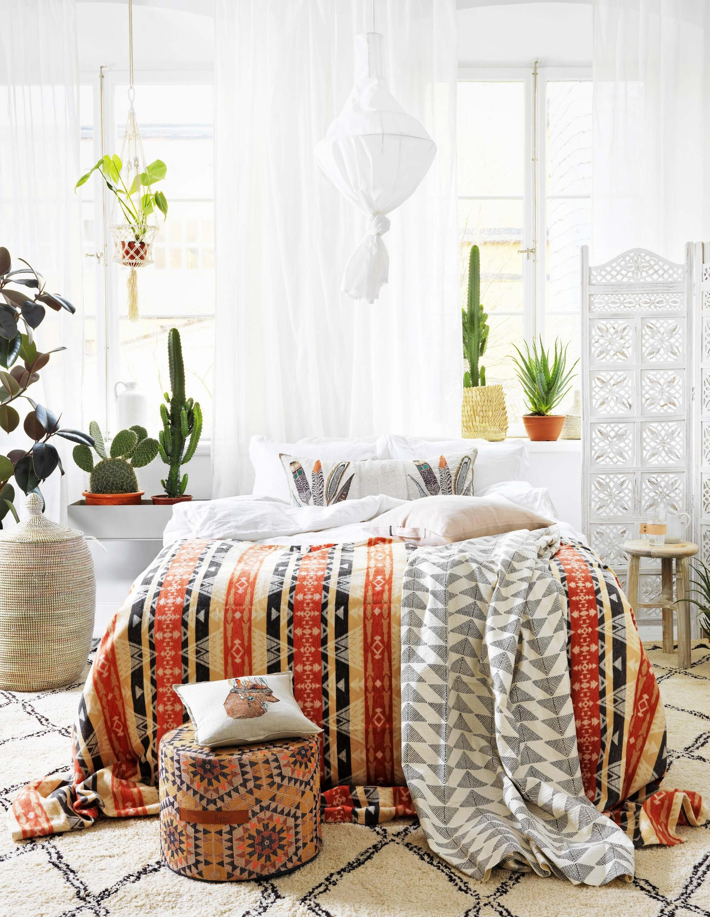 A Scandi boho bedroom with colorful plaid Chic apartment