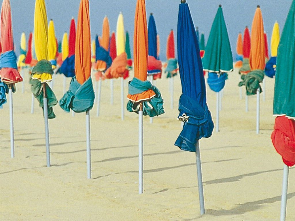 The coloured umbrellas on the beach at Deauville, France.  Oh so lovely.