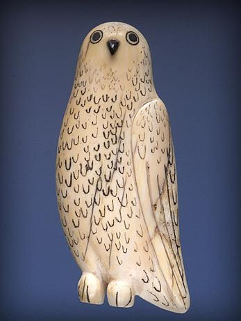 Owl Pendant, 1903–1905  Collected on Herschel Island, Inuvialuit region   Ivory, baleen, black colouring  7.5 x 3 x 0.5 cm