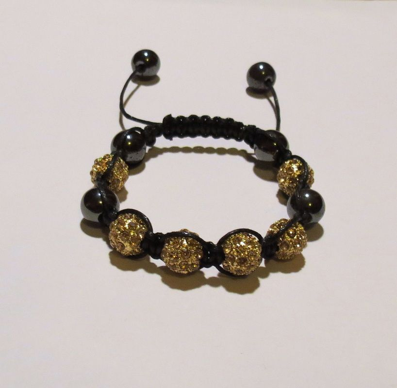 10mm Ceramic Rhinestone Pave Bead Macrame Bracelet in Gold. With Hematite beads too. Comes in Red, White, Blue, Gold and Pink.