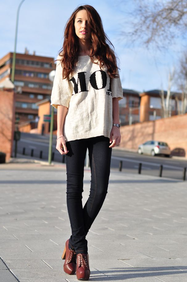 Cute. Oversized sweater over dark jeans and wine colored Alex Silva booties.