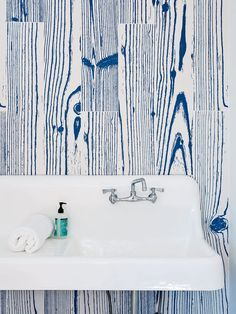 White-and-blue, wood-grain–patterned UonUon tiles by 14oraitaliana in bathroom of Rhode Island family vacation home by Bernheimer Architecture.