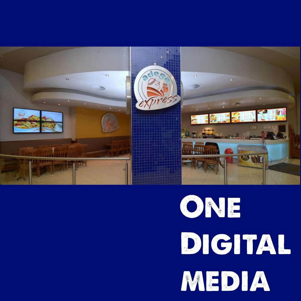 """One Digital Media installed a 2x2 40"""" screen video wall at Adega's Express in Sandton City. Digital Menu Boards were installed at the counter to display the menu items and promotions to customers. Send us your pictures when you visit the store. #onedigitalmedia #digitalmenuboards #digitalmarketing"""