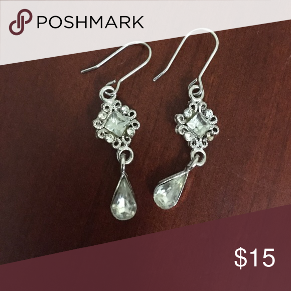 Drop earrings Beautiful and detailed drop earrings. Center diamond shaped stone with 4 accent stones and twisting detail with larger pear shaped drop stone Jewelry Earrings