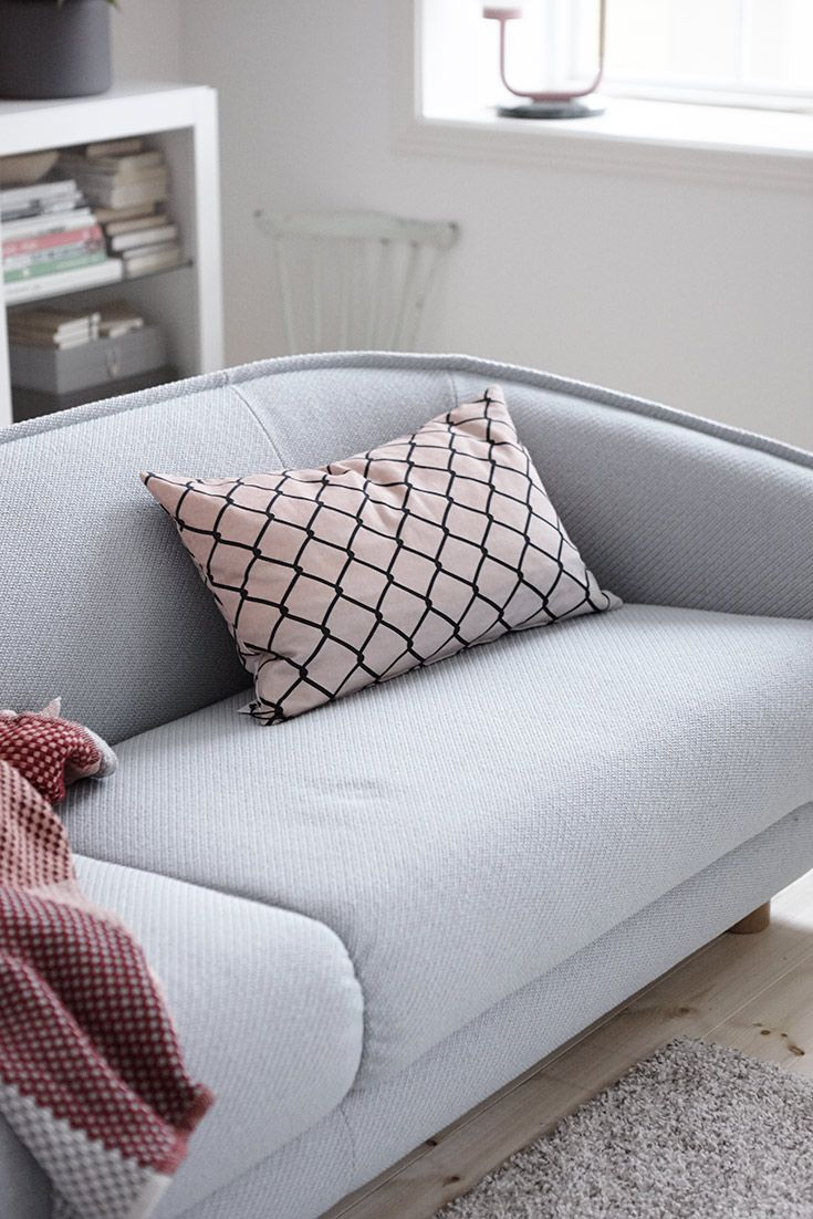 Sober sofa with pillow and blanket
