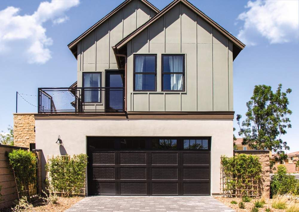 Modern Farmhouse Home Design With Our Carriage House Steel Garage Door Modern Farmhouse Floorplan Modern Farmhouse Garage Doors