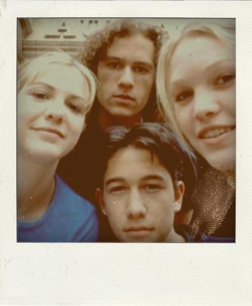 "Heath Ledger, Joseph Gordon-Levitt, Julia Stiles, and Larisa Oleynik in a Polaroid taken on the set of 1999′s ""10 Things I Hate About You""."