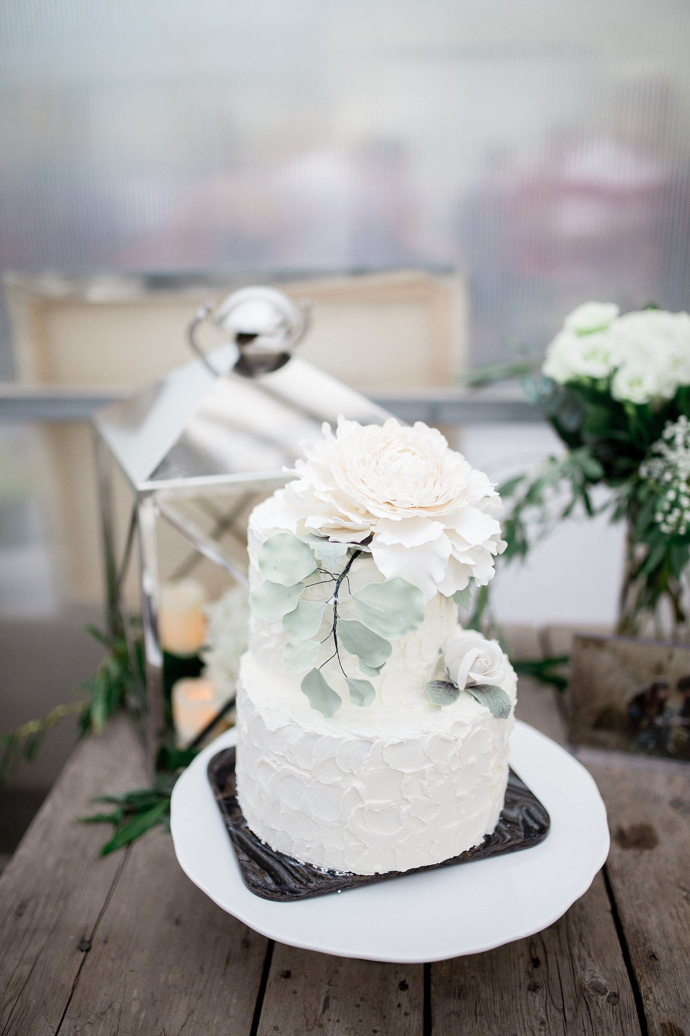 Simple wedding decoration ideas for reception  Simple white wedding cake with flowers  Greenhouse wedding