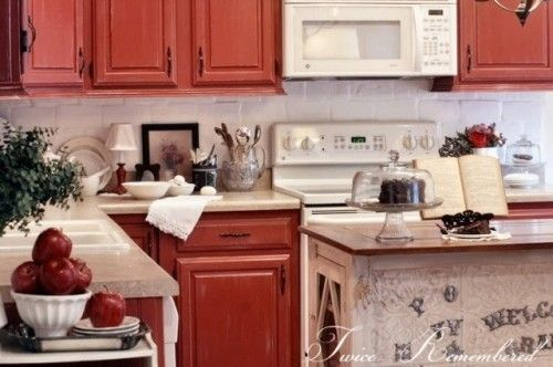 Love the red distressed cabinets! I need this in my ...