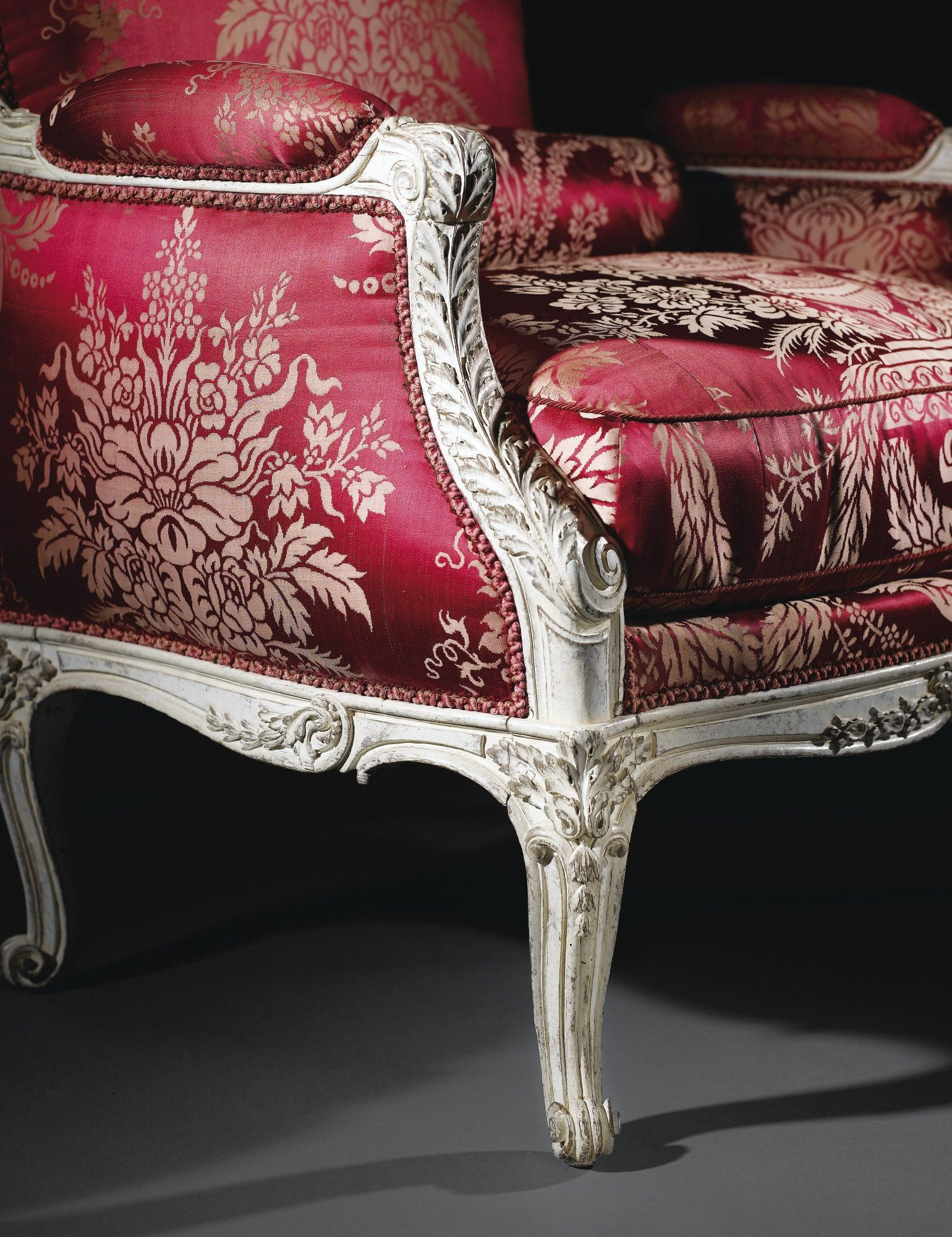 A Carved White Painted Bergere By Nicolas Quinibert Foliot