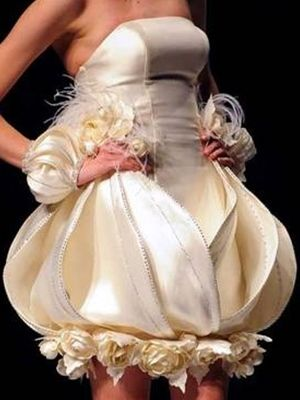 36bd986fd88 Ugly wedding dresses-Not sure what strikes me exactly... possibly the  layering... the wired edges