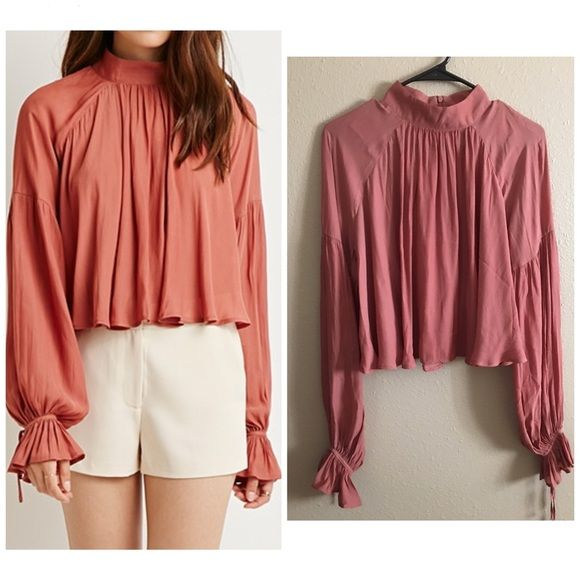 Romantic lightweight top From the F21 contemporary collection. Color is amber, sort of burnt orange color. Long sleeves, concealed back zipper Unlined, woven 100% polyester Hand wash cold. Worn once. Excellent condition. NO TRADES Forever 21 Tops Blouses