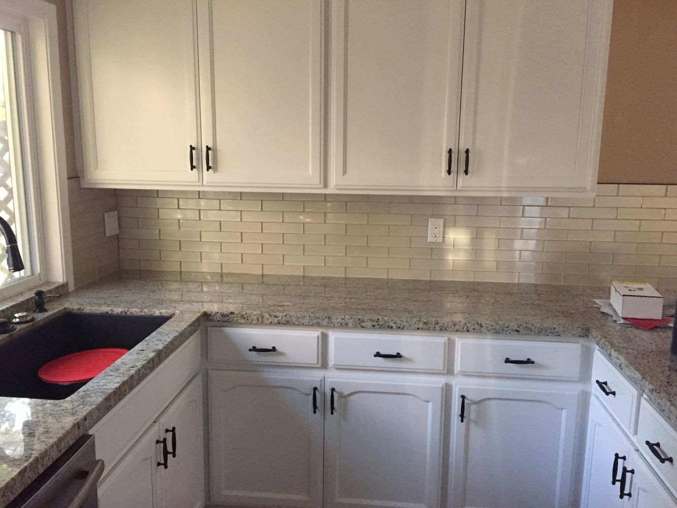 My kitchen antique white cabinets ivory ceramic beveled subway swiss coffee over oak cabinets champagne glass mosaic backsplash giallo ornamental granite dailygadgetfo Gallery
