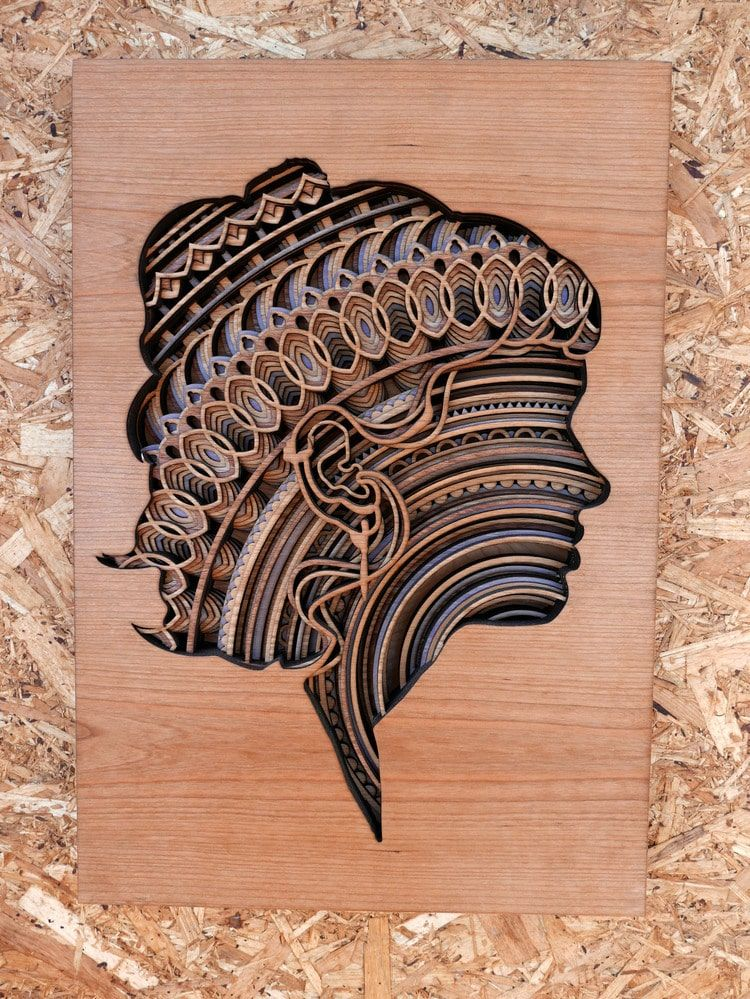 Mesmerizing laser cut wood sculptures feature layers of intricate patterns