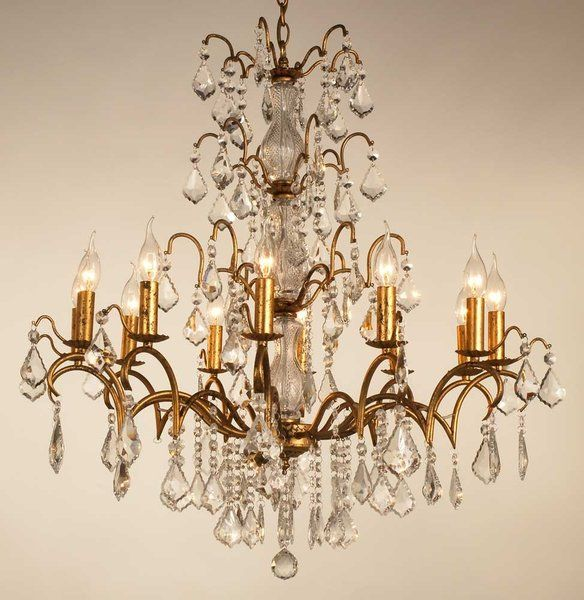 Stunning antique gold 12 arm chandelier great gatsby interiors this crystal cut antique gold chandelier features aloadofball Images