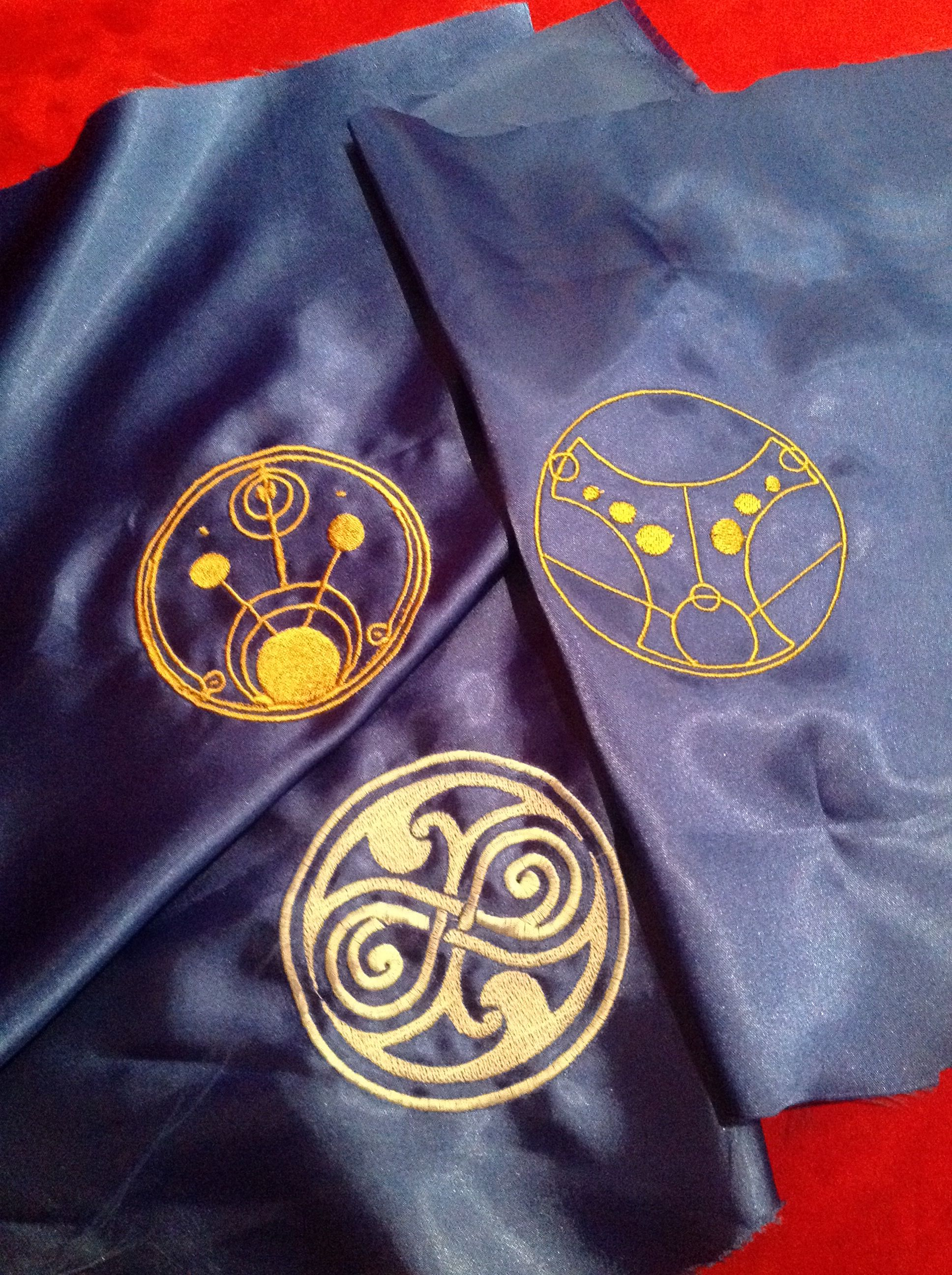 Galifreyian symbols embroidered on Satin for a Tardis