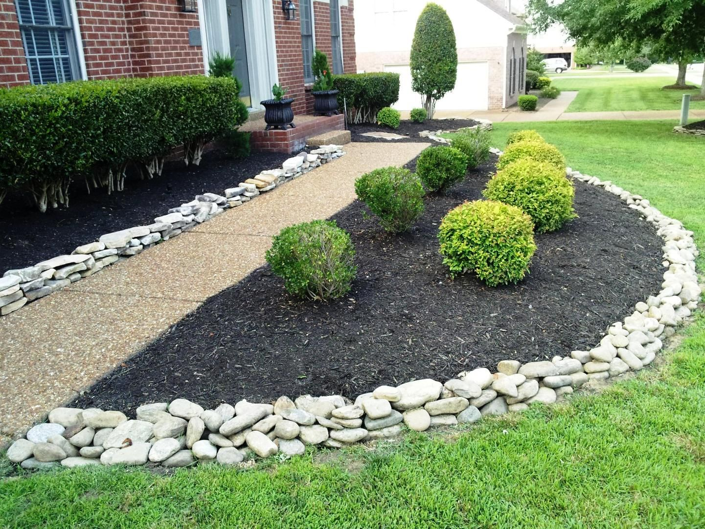 Red house landscape with white rock river rock for Garden designs with rocks