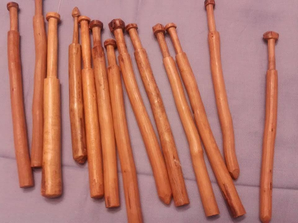 Bobbins made out of small branches of bitch or juniper,and they are used for Nyytinki Lace found in Karlian Finland.