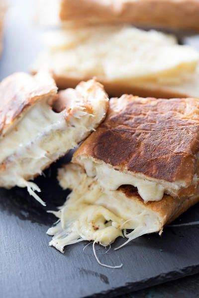 These fondue cheese panini sandwiches will satisfy any cheese lover in your life. Plus, they're so easy to whip up! French bread filled with fondue cheese and pressed to make the perfect panini sandwich! #fonduecheese