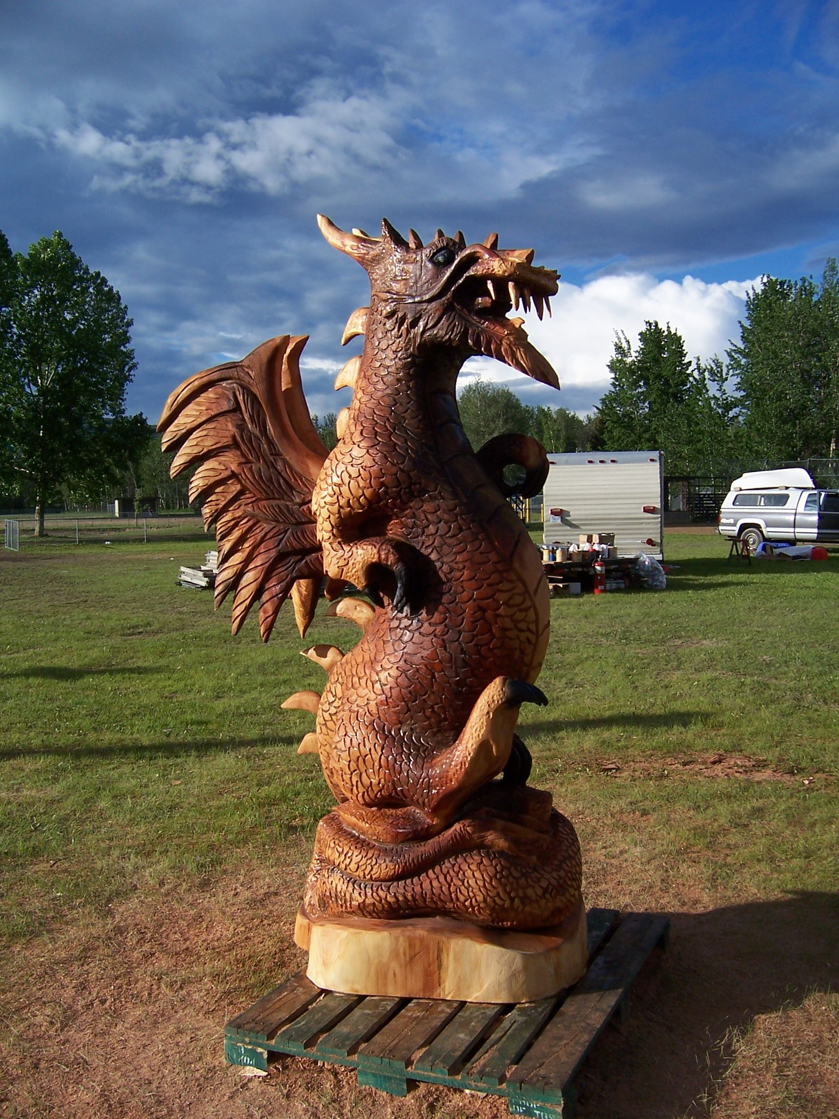 Chainsaw carved dragon by pioneer log homes of bc wood