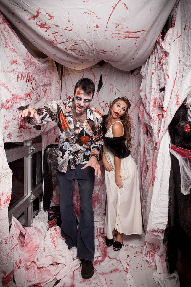 10 halloween photo booths your party needs halloween photos photo love this halloween party photo booth idea just pick a corner in your house take some old sheets from the thrift store smear fake blood everwhere solutioingenieria Images