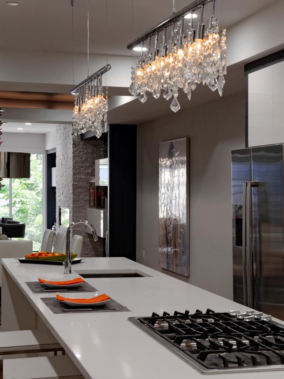 This Modern Kitchen Has Neutral Colors That Provide A Sleek Modern Look The White Countertop And Stainless Steel Appliances Contribute To Modern Kitchen Island Kitchen Wall Colors Modern Track Lighting