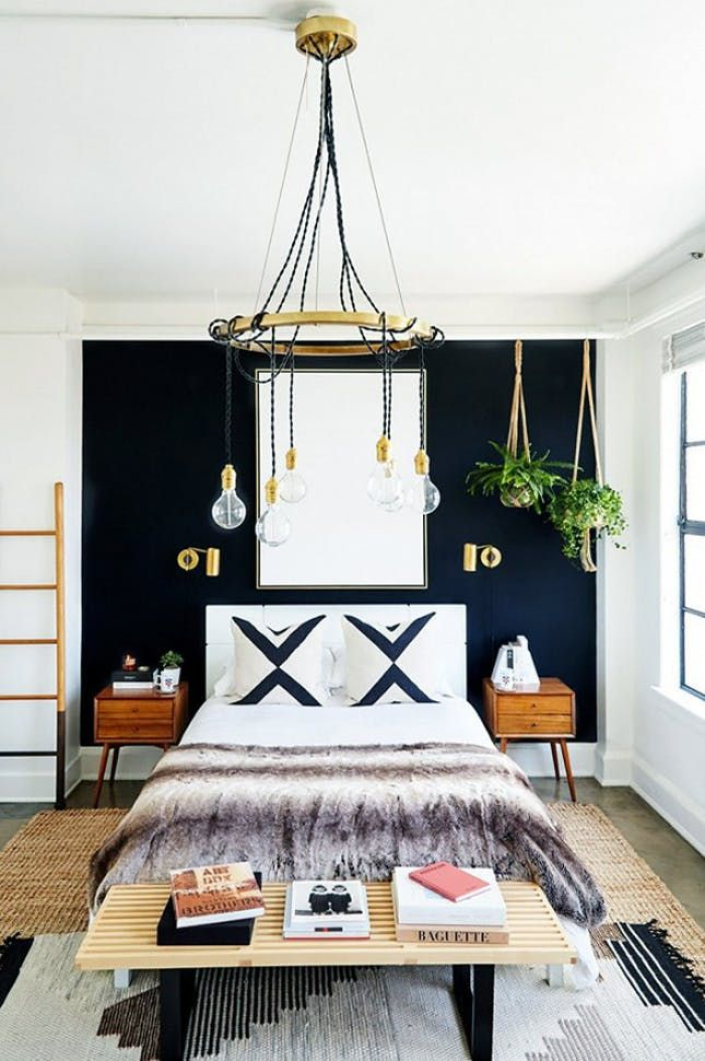 cozy blue black bedroom bedroom. this bold bedroom is all about its high-contrast black and white palette, warmed up by wood, jute brass. be fearless with graphics\u2014and wall cozy blue