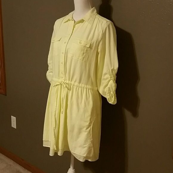 EUC Gap Tie String Shirt Dress in Bright Yellow Collared with slight pleating, drawstring waist, button up sleeves, deep side pockets and two layers of bottom hem. Tagged size small but I personally think GAP runs larger than other brands I wear. This yellow is not canary but closer to a fluorescent highlighter! Top of shoulder to bottom of dress is 33 inches, breast line 19 inches across laying flat. Sleeve inseam unbuttoned is 18 inches. 100% cotton (heavier weight brushed cotton) very…