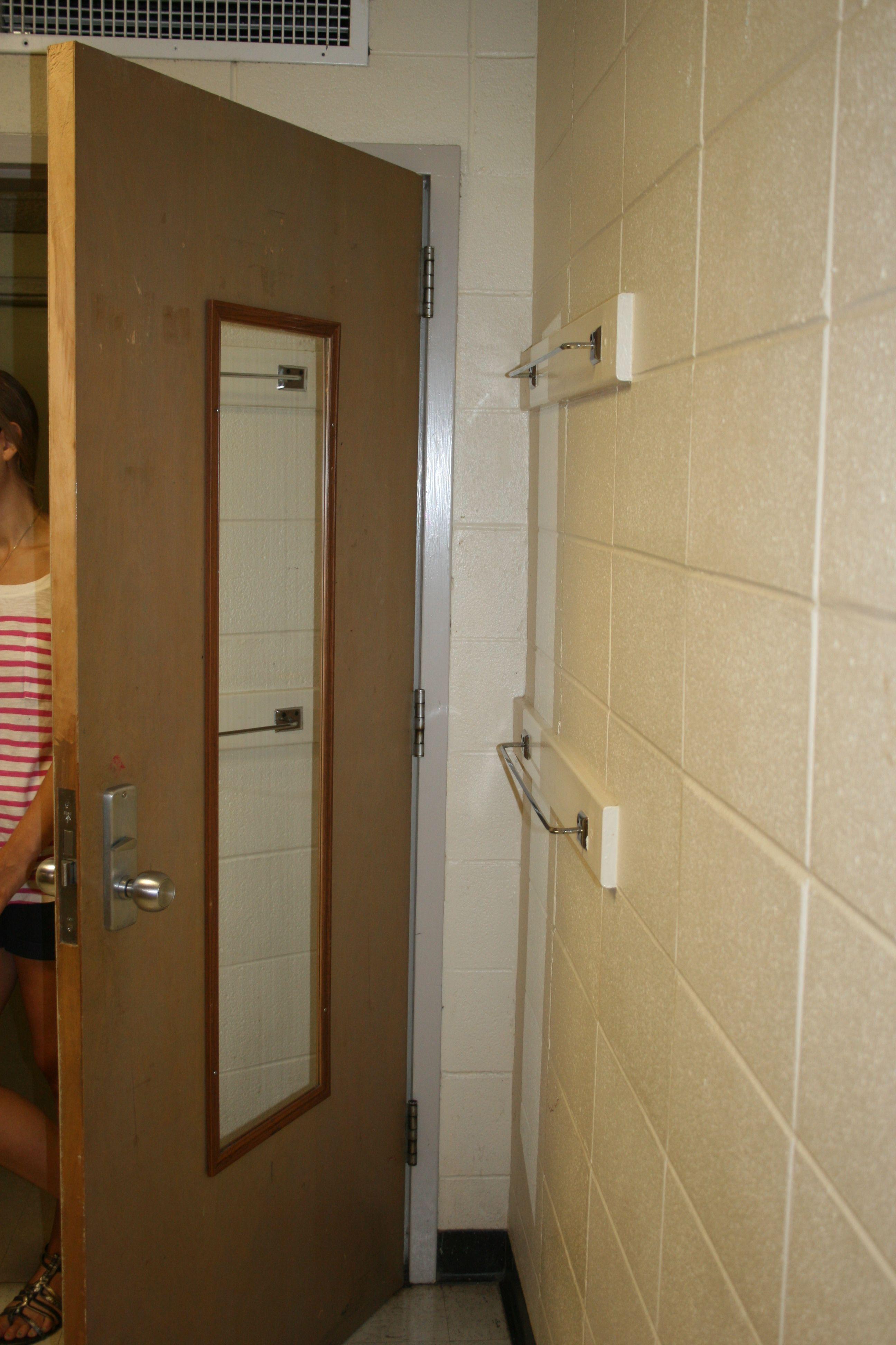 Genial Towels Rods And Mirror Behind Door.