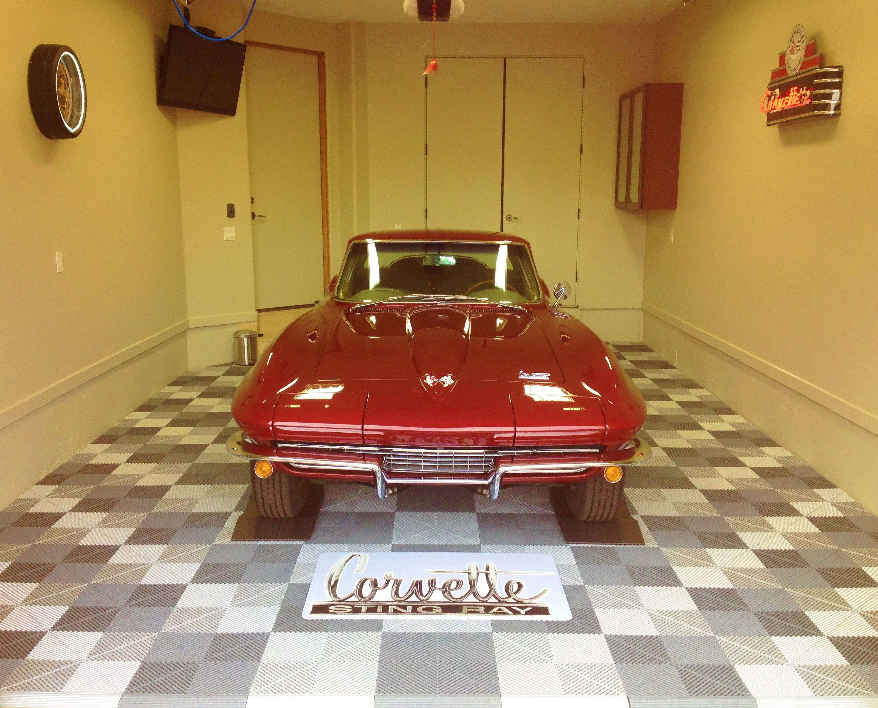 A classic corvette on our ribtrax floor garage