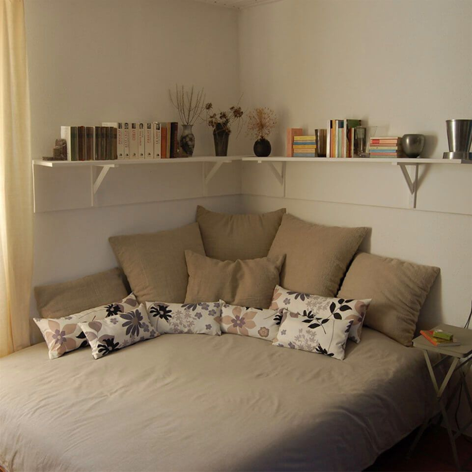 Corner living with lots of pillows for the home bed in - Small bedroom decorating ideas on a budget ...