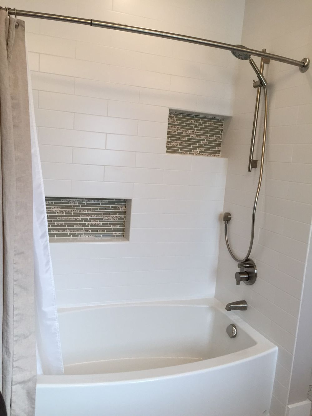 shower with white tile and kohler expanse tub love it in