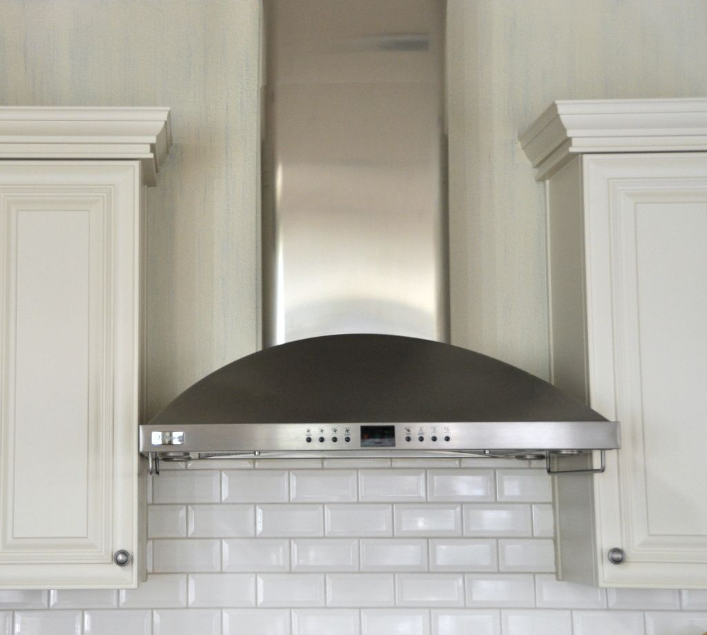 Subway tile backsplash note where tile stops and starts for Kitchen exhaust hood
