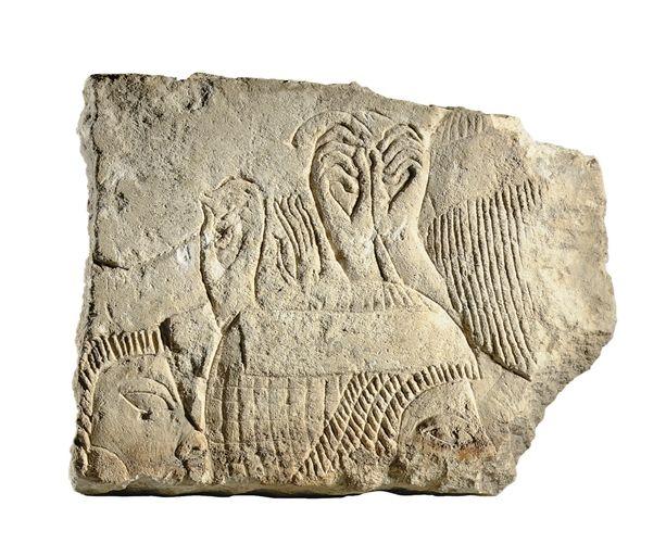 AN EGYPTIAN LIMESTONE RELIEF NEW KINGDOM, LATE DYNASTY XVIII, 1353-1307 B.C.