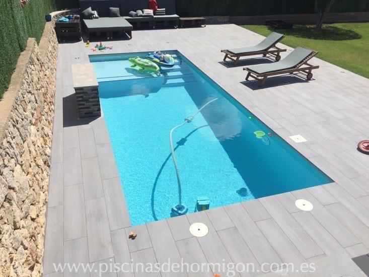 Piscina de hormigon clasica y escalera serrano 7x4 for Costo piscinas hormigon