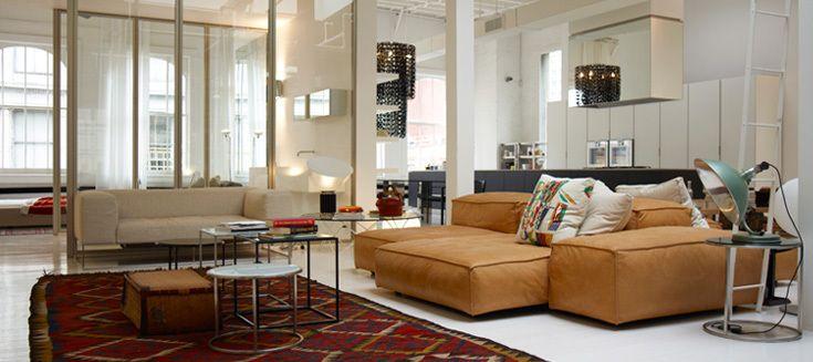 After - Piero Lissoni for Living Divani - Extra Soft sofa series, Ile Club sofa, Ile side tables. Pillows shown in reissued Gio Ponti fa...