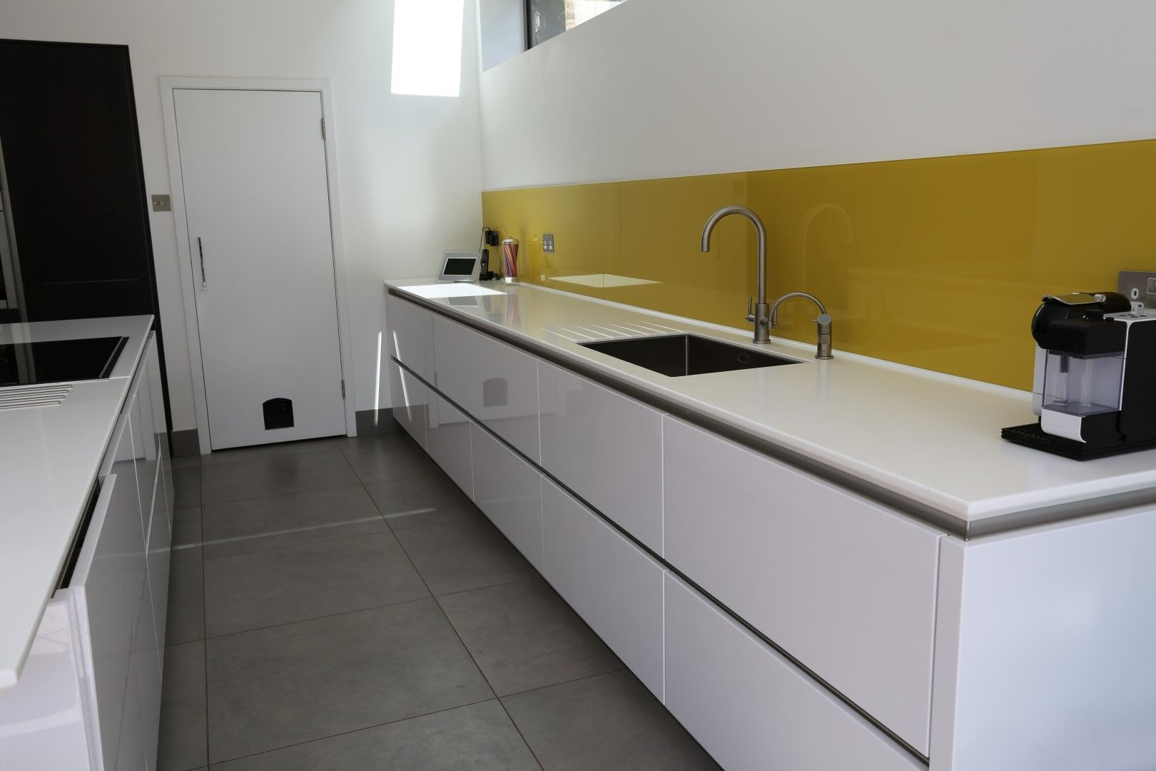 White kitchen yellow splashback google search dublin for Sink splashback ideas