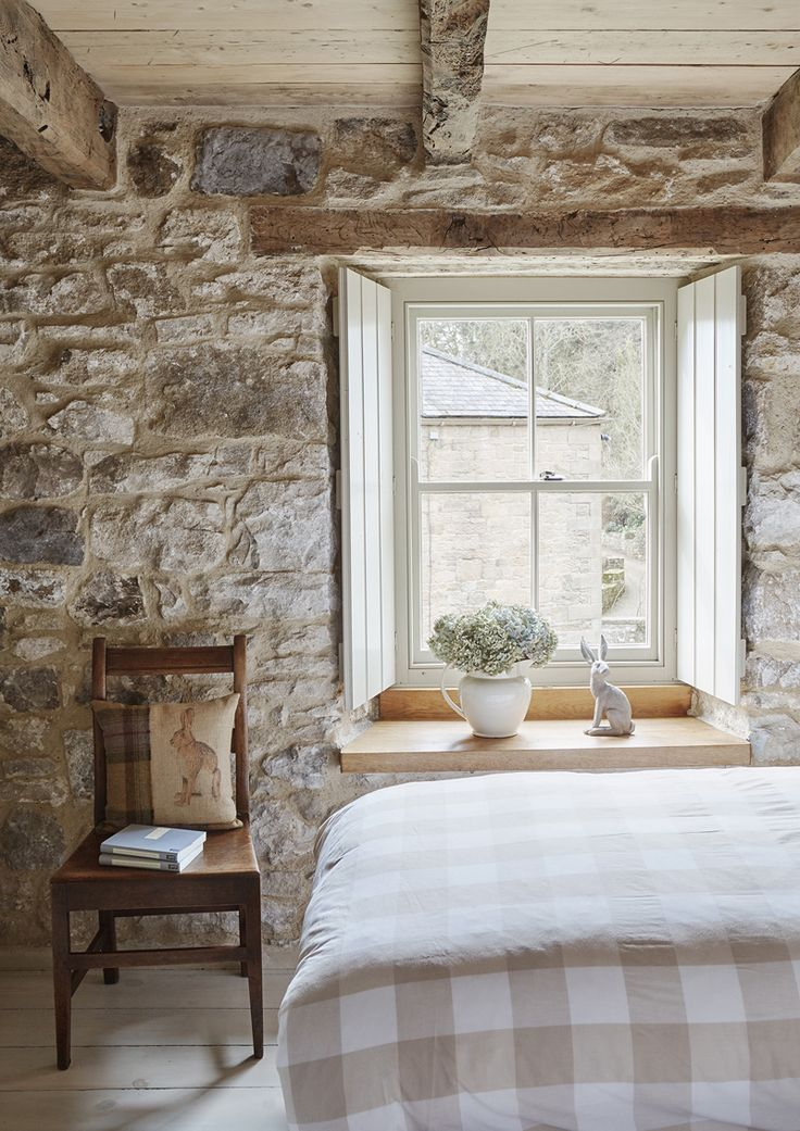 Bedroom with stone wall in an ancient home in the north for Casa interni