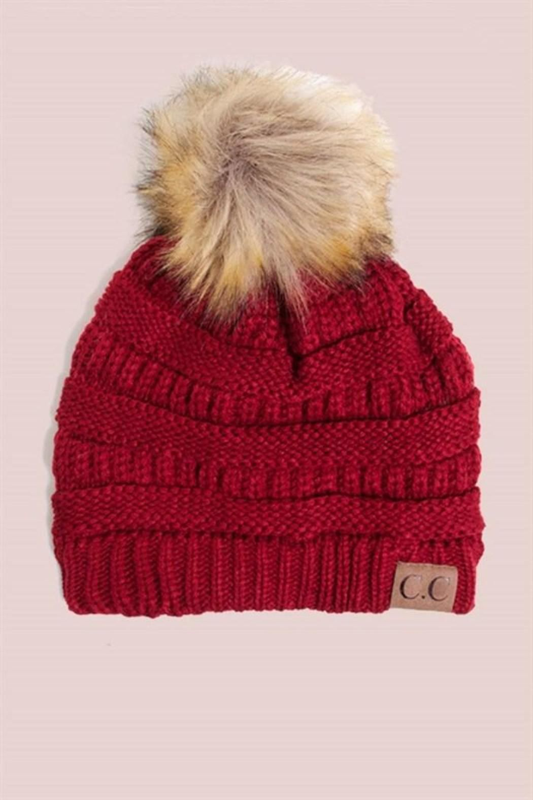 Solid ribbed beanie features a fur pom pom. Red Beanie by C.C.. Accessories  - Hats Minneapolis 73a875d89