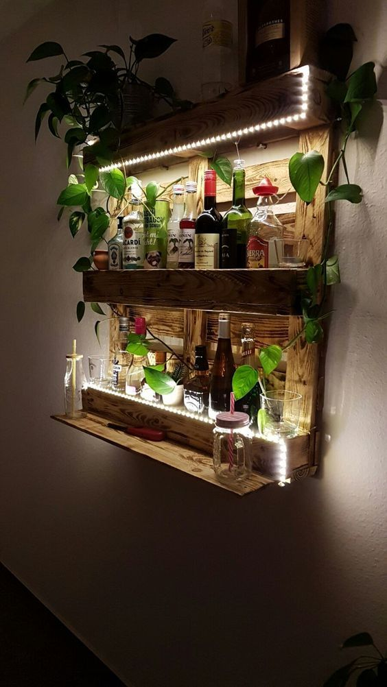 A large DIY pallet shelf with integrated lighting! An eye-catcher in each apartment and roommate! #ideas #palettes #diy #regal #led